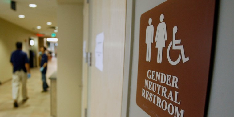 FILE - In this Aug. 23, 2007, file photo, a sign marks the entrance to a gender-neutral restroom at the University of Vermont in Burlington, Vt.