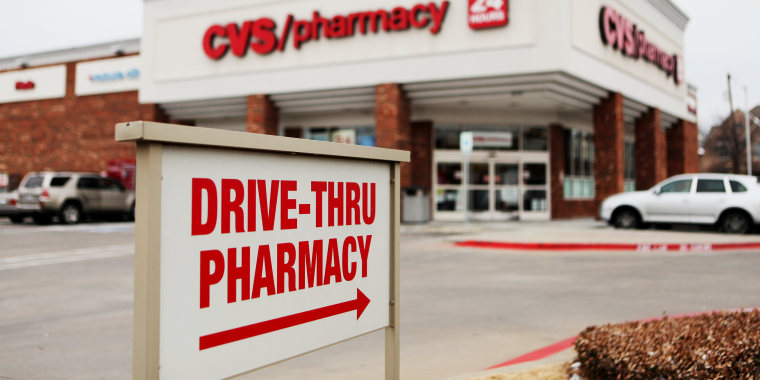 """Image: A """"Drive-Thru Pharmacy"""" sign is displayed outside of a CVS Caremark Corp. store"""