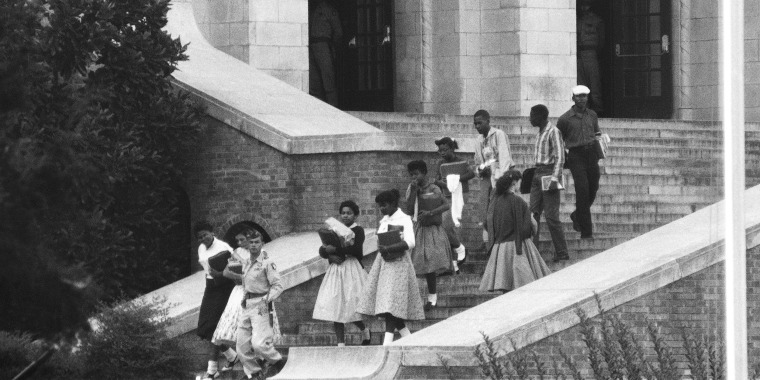 Image: Seven of the nine African American students walk onto the campus of integrated Central High School