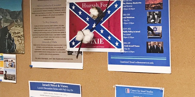 Image: A confederate flag poster with a cotton plant is seen hanging at American University.