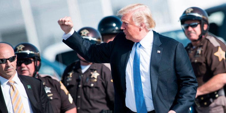 Image: US President Donald Trump walks from motorcycle police to Air Force One at Indianapolis International Airport