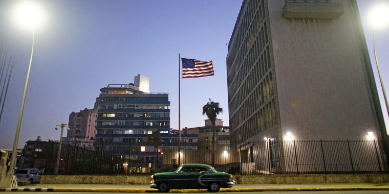 Image: FILE PHOTO: A vintage car passes by in front of the U.S. Embassy in Havana, Cuba