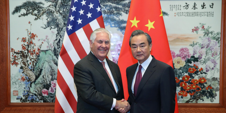 Image: U.S. Secretary of State Rex Tillerson (L) shakes hands with Chinese Foreign Minister Wang Yi (R) before their meeting at the Great Hall of the People in Beijing