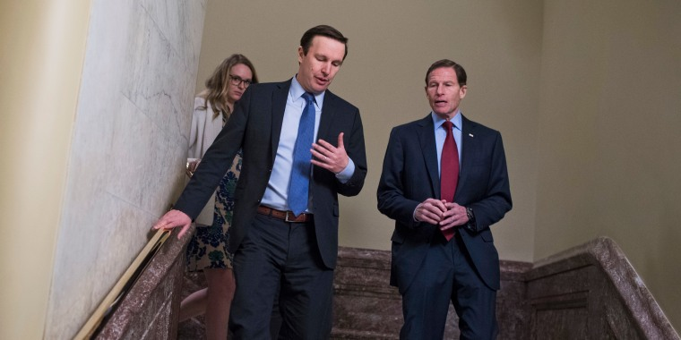 Sens. Chris Murphy, left, and Richard Blumenthal talk in the Capitol on April 4, 2017.