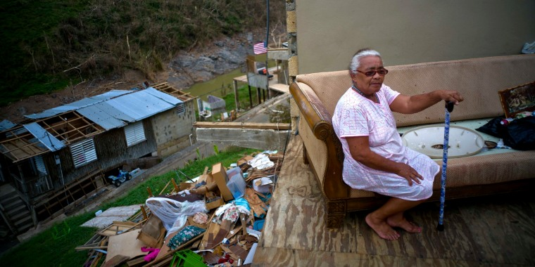 Juana Sortre Vazquez sits on her soaked couch in what remains of her home, destroyed by Hurricane Maria, in the San Lorenza neighborhood of Morovis, Puerto Rico, Saturday, Sept. 30, 2017.