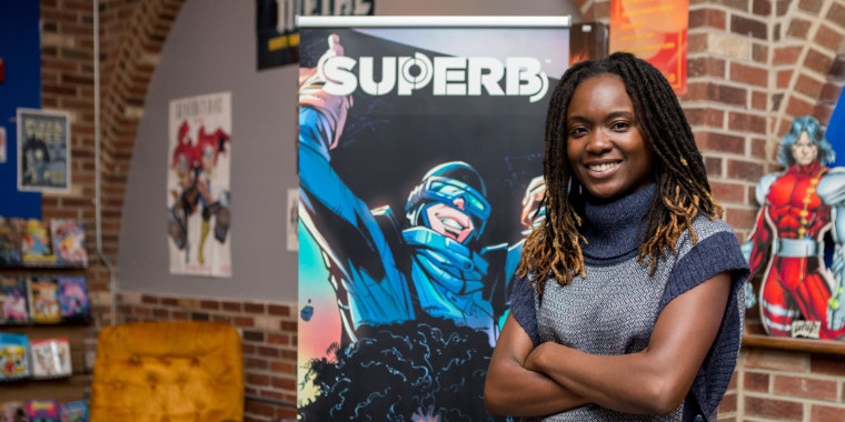 "Dr. Sheena Howard poses with the cover art from her book, ""Superb"""