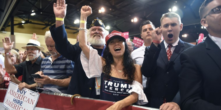 Image: Supporters cheer as President Donald Trump speaks at a rally in Phoenix