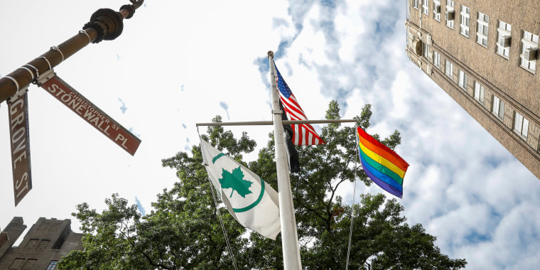 Image: The Rainbow Flag, a symbol of LGBTQ freedom, flies over the Stonewall National Monument following a dedication ceremony in New York