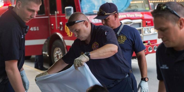Emergency responders tend to a woman believed to be overdosing on methamphetamine in Charleston, West Virginia, in July.