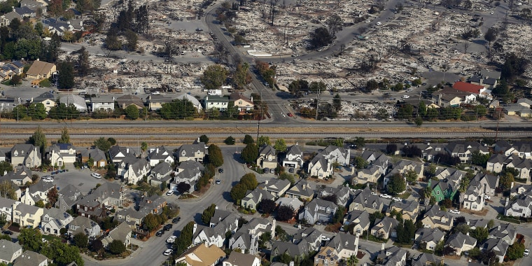 Image: Homes destroyed from fires are seen from an aerial view in Santa Rosa,
