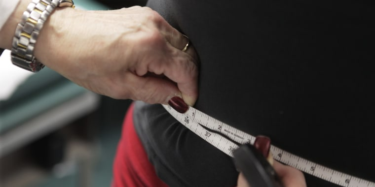 In this Jan. 20, 2010, file photo, a waist is measured during an obesity prevention study in Chicago.