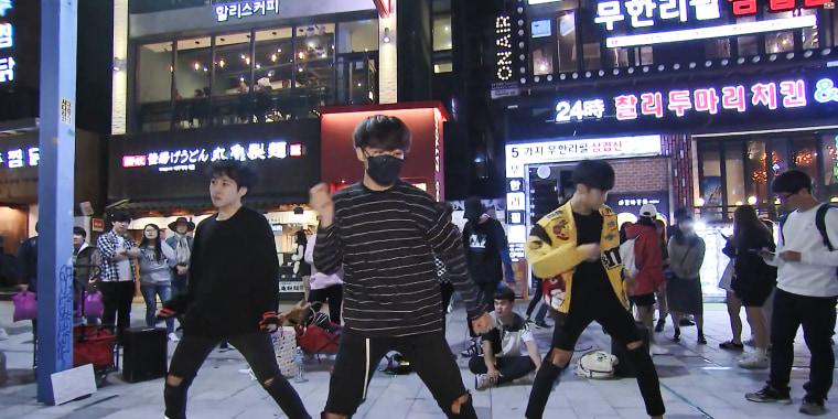 Yang Seung Ho's K-pop dance group performs in Seoul's Hongdae district on Thursday.