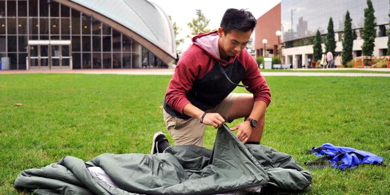 Image: Vick Liu unrolls his TravlerPack, a lightweight sleeping bag, outside the Kresge Auditorium at the Massachusetts Institute of Technology in Cambridge, Massachusetts, Oct. 6, 2017.