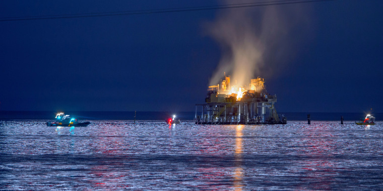 Authorities respond to an oil rig explosion in Lake Pontchartrain, off Kenner, La., on Sunday, Oct. 15, 2017.