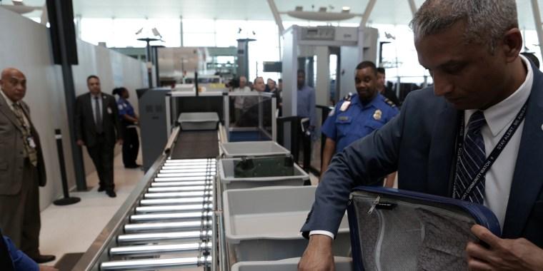 Image: A TSA Official Removes a Laptop