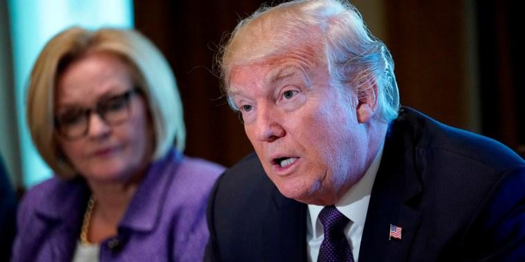 Image: US President Donald Trump speaks next to Senator Claire McCaskill
