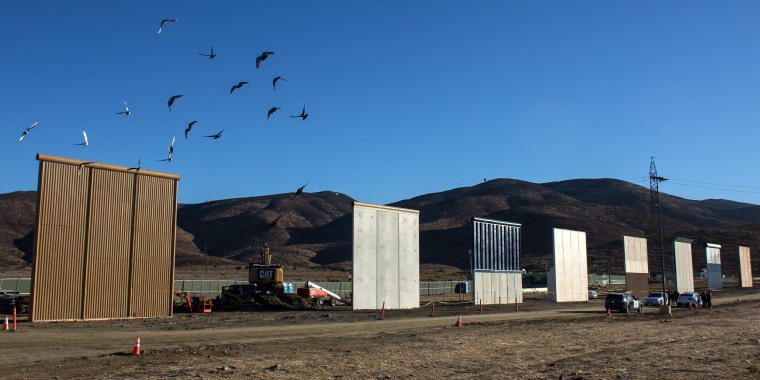 Image: Eight prototypes of President Donald Trump's US-Mexico border wall being built near San Diego, California