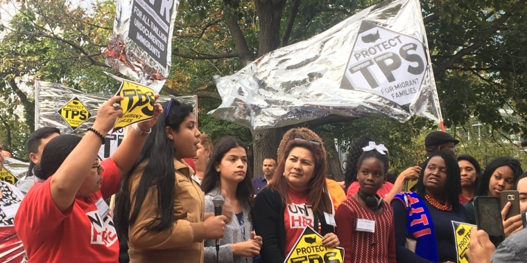 """Temporary Protected Status holders chant """"TPS Yes! Deportation No!"""" in Washington D.C."""