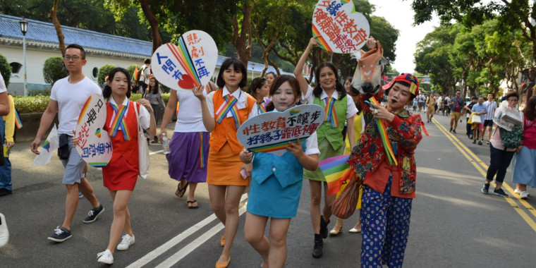 Parade-goers march in the 15th annual pride LGBT parade in Taipei, Taiwan. This year's event drew an estimated 123,000 people.