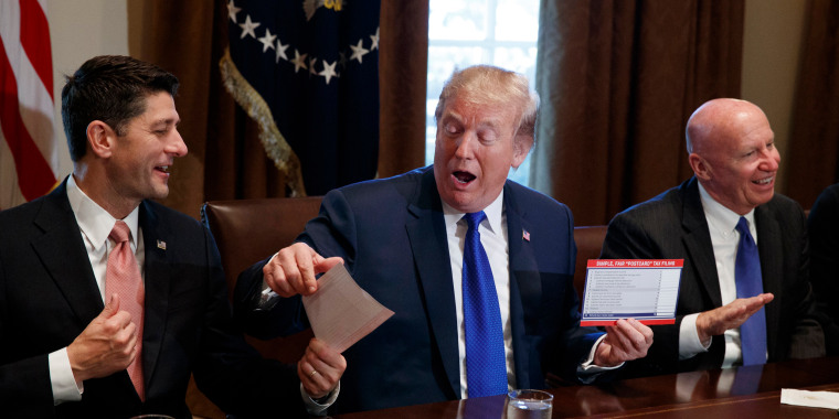 Image: Trump Holds An Example Of What A New Tax Form May Look Like During
