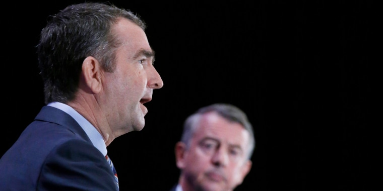 Democratic gubernatorial candidate Lt. Gov. Ralph Northam, left, makes a point as GOP gubernatorial candidate Ed Gillespie watches at the Omni Homestead Resort in Hot Springs, Virginia, on July 22.
