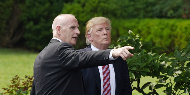 Keith Schiller, deputy assistant to the president and director of Oval Office operations, talks to President Donald Trump on the South Lawn of the White House on June 12.