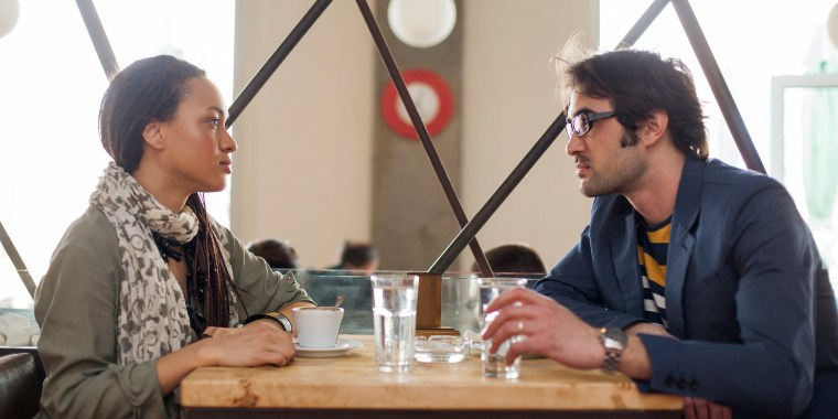 Image: A couple talks in a cafe