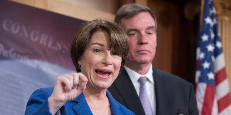 Image: Democratic Senator from Minnesota Amy Klobuchar and Democratic Senator from Virginia Mark Warner