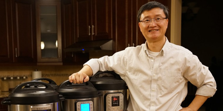 Robert Wang stands next to his line of Instant Pot multi-cookers.