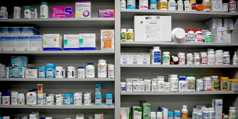 Image: Bottles of Medications Line the Shelves at a pharmacy in Portsmouth