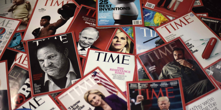 Image: Copies of Time magazine are displayed on a table in Washington