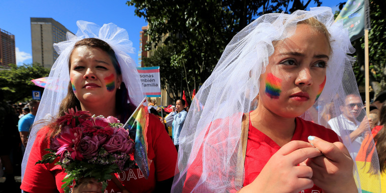 Image: People attend an annual gay pride parade in Bogota, Colombia