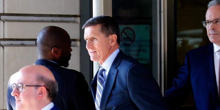 Image: Former U.S. National Security Adviser Michael Flynn departs after plea hearing at U.S. District Court in Washington