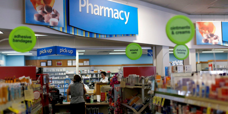 Image:  A customer waits at the counter of a CVS Pharmacy store in Pasadena