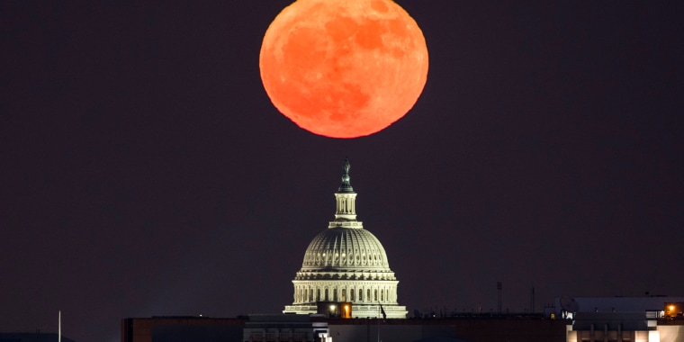 Image: The supermoon rises above the U.S. Capitol in Washington