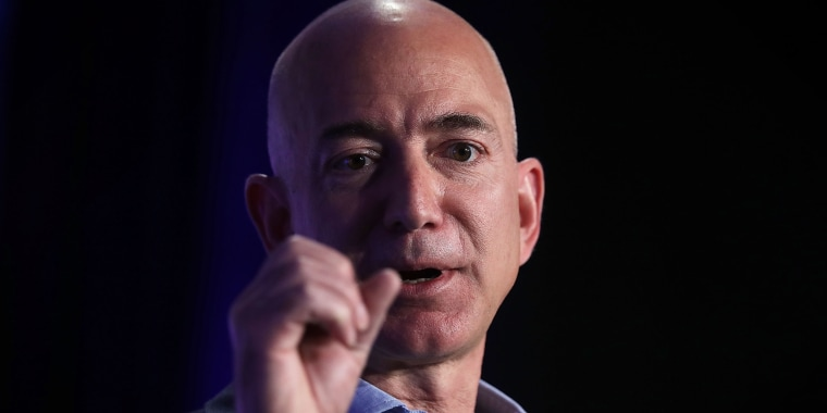 """Image: Jeff Bezos speaks during an event called """"Transformers: Pushing the Boundaries of Knowledge"""""""