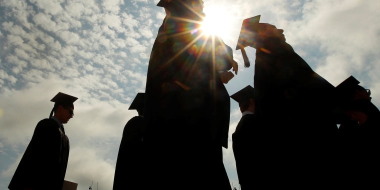 Image: FILE PHOTO: Graduating students arrive for Commencement Exercises at Boston College in Boston