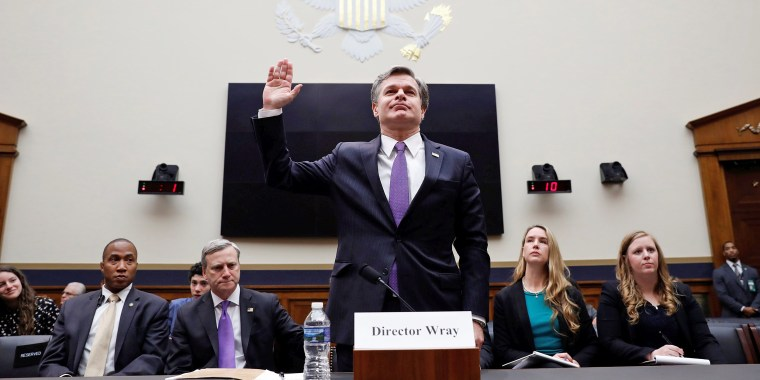 Image: FBI Director Christopher Wray is sworn in before a House Judiciary Committee hearing on Capitol Hill in Washington