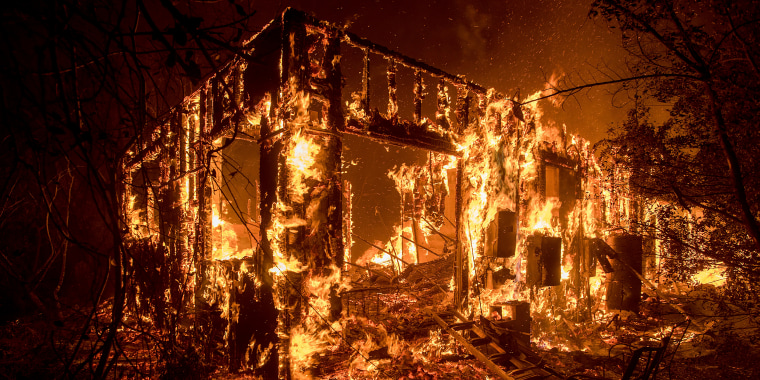 Image: Flames consume a home