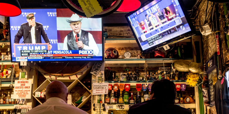 Image: A television at OK Bicycle Shop in Mobile airs a local Fox affiliate's story about the special election, announcing President Donald Trump's endorsement of Moore.