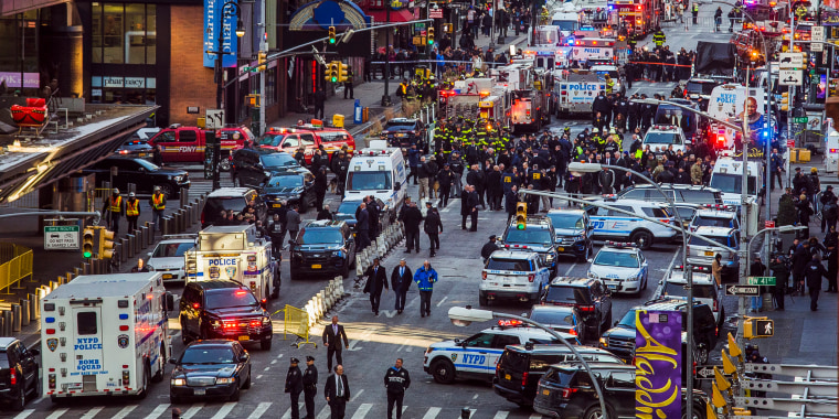 Image: Law enforcement officials work following an explosion