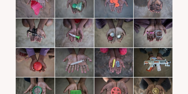 Image: Rohingya children hold objects they use as toys to play with in refugee camps in Bangladesh's Cox's Bazar