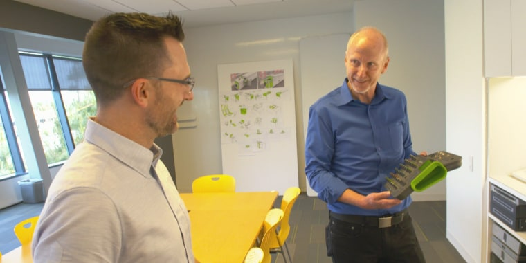Chet Pipkin (right), founder and CEO of Belkin, speaks to employee in California-based office. He says he's learned how to be a better leader.