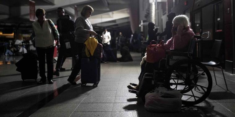Image: Passengers wait after the lights went out at Hartfield-Jackson Atlanta International Airport, Dec. 17, 2017, in Atlanta.