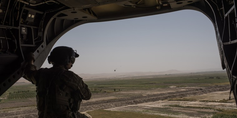 Image: A U.S. Army helicopter flies from Camp Shorab to Camp Bost
