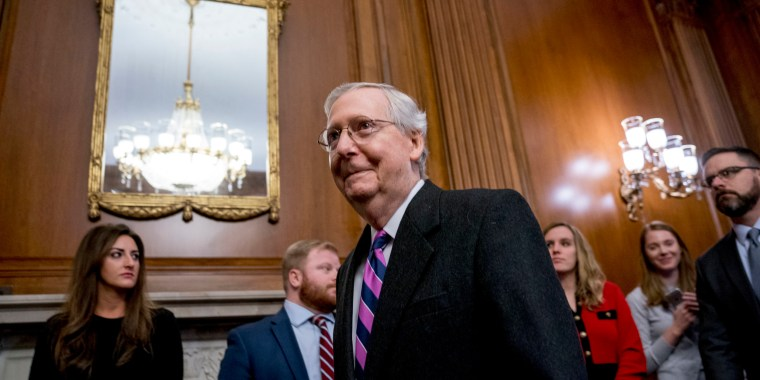 Image: Senate Majority Leader Mitch McConnell of Kentucky, arrives to sign the final version of the GOP tax bill during an enrollment ceremony at the Capitol in Washington, Dec. 21, 2017.