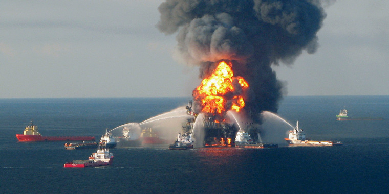 Image: File photo of fire boat response crews battling the blazing remnants of the offshore oil rig Deepwater Horizon off Louisiana