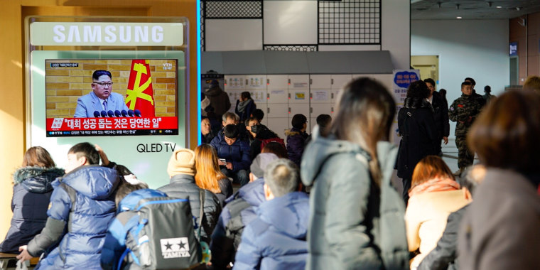 Image: South Koreans in Seoul's main train station watch Kim Jong Un address