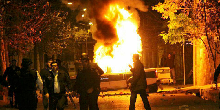 A vehicle burns as demonstrators protested high prices and the poor state of the economy in Dorud, in Iran's Lorestan province, on Dec. 30.