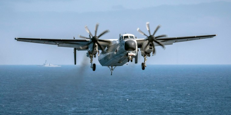 Image: A C-2A Greyhound assigned to the Providers of Fleet Logistics Support Squadron (VRC) 30, prepares to land on the flight deck aboard the aircraft carrier USS Theodore Roosevelt (CVN 71) on Aug. 22, 2017.
